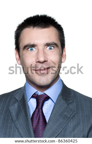 Closeup portrait of a surprised handsome mature man with eyes wide open in studio on isolated white background - stock photo