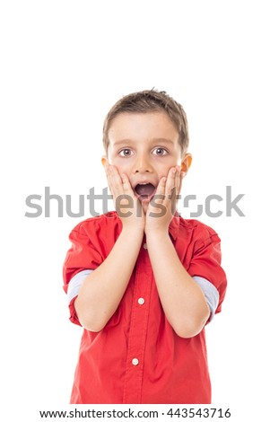 Closeup portrait of a surprised little boy isolated on white background - stock photo