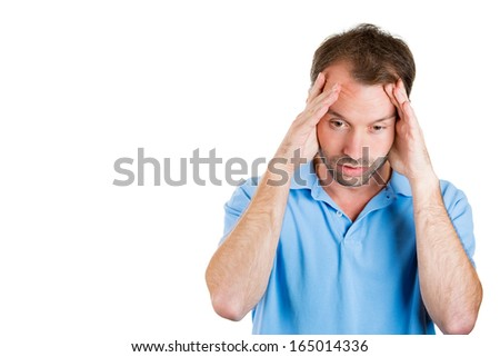 Closeup portrait of a upset worried sad, depressed, tired business man with a headache and very stressed, isolated on white background with space to left, Negative human emotion facial expression - stock photo