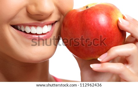 closeup portrait of a womans face with an apple - stock photo