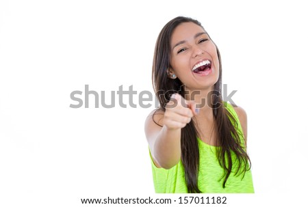 Closeup portrait of a young, beautiful, excited, happy, laughing woman, pointing finger towards you and to the camera, isolated over white background with copy space. Positive human emotions - stock photo