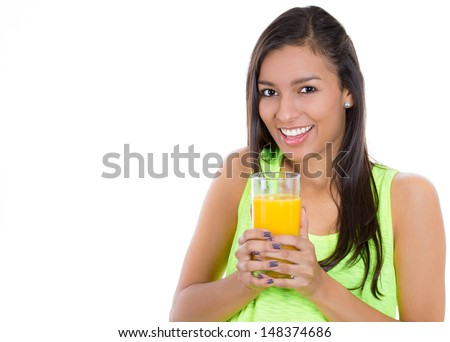 Closeup portrait of a young beautiful female holding a glass of orange juice, isolated on white background. Nutrition weight loss program. - stock photo