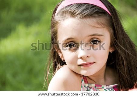 Closeup portrait of a young beautiful girl. - stock photo