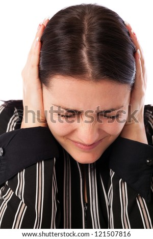 Closeup portrait of a young businesswoman covering ears with her hands isolated on white background