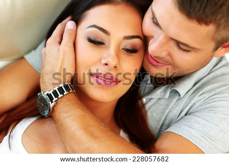 Closeup portrait of a young couple hugging - stock photo