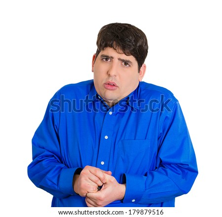 Closeup portrait of a young distressed, nervous looking man, very timid, shy and anxious, playing, fumbling with hands , isolated on white background. Mental health, emotion facial expression feeling - stock photo