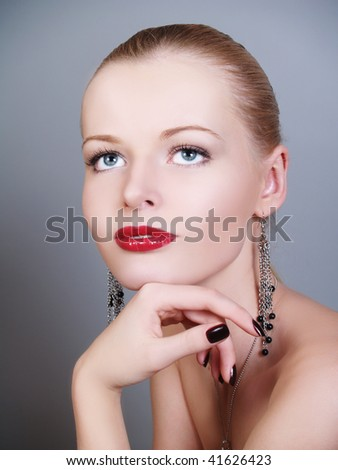 Closeup portrait of a young female with juicy red lips - stock photo