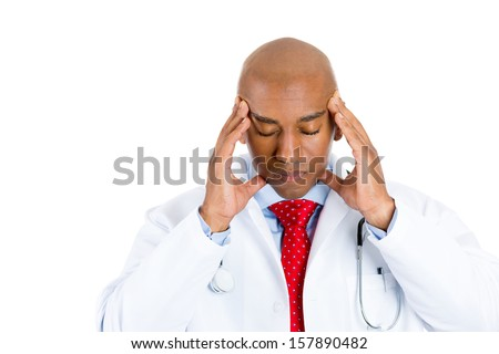 Closeup portrait of a young male doctor, having bad news, headache, stressed out, going through a lot of stress isolated on white background. Health care reform, medicaid plan reimbursement. Obamacare - stock photo