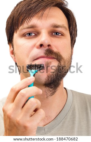 Closeup portrait of a young man  shaving his beard isolated on white background - stock photo