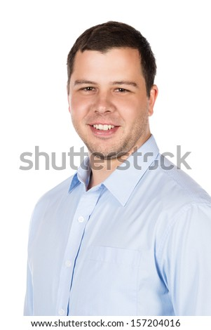 Closeup portrait of a young professional adult male wearing a blue buttoned shirt. Image is isolated on a white background.