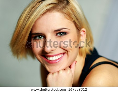 Closeup portrait of a young smiling woman - stock photo