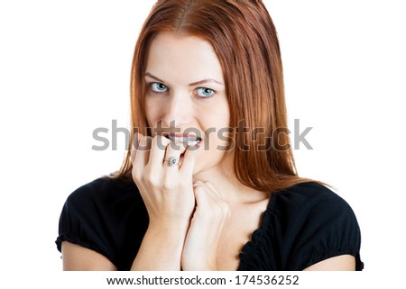 Closeup portrait of a young unsure hesitant nervous woman biting her fingernails craving for something or anxious, isolated on white background. Negative human emotions facial expressions feelings - stock photo