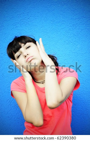 Closeup portrait of a young woman having headache - stock photo