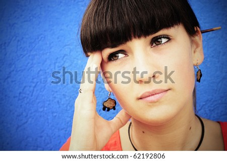 Closeup portrait of a young woman looking depressed - stock photo