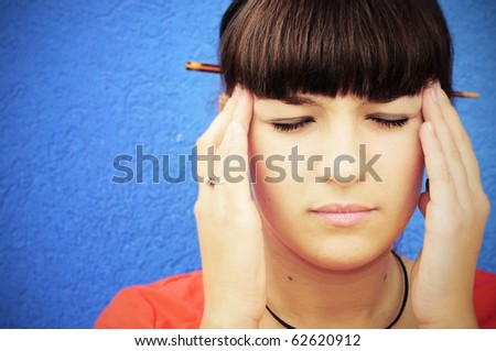 Closeup portrait of a young woman looking stressed - stock photo