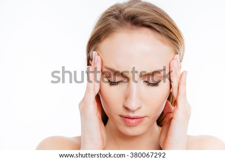 Closeup portrait of a young woman with headache isolated on a white background - stock photo