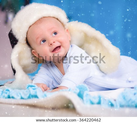 Closeup portrait of adorable baby boy i snow - stock photo