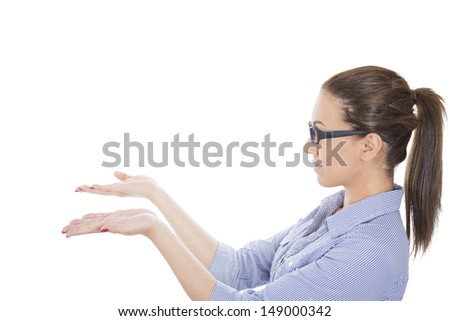 Closeup portrait of adorable, beautiful woman with glasses and blue shirt, arms pointing to copy space, isolated on white background - stock photo