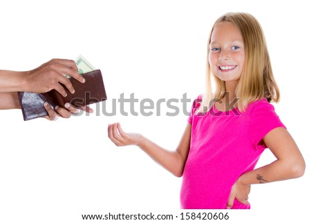 Closeup portrait of adorable girl smiling and demanding money for allowance, guy pulls out money from wallet to give her, isolated on white background - stock photo