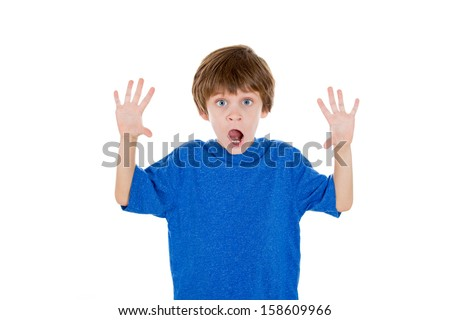 Closeup portrait of adorable kid surprised and shocked with hands up in air, isolated on white background - stock photo