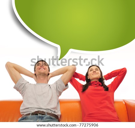 Closeup portrait of adult couple sitting on their sofa at their apartment and dreaming about something. Blank balloon at the top of the photo for your text. Planning future concept - stock photo