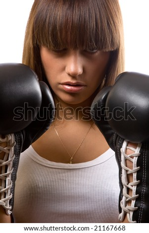 closeup portrait of aggressive girl with boxing gloves