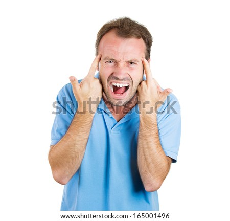 Closeup portrait of an angry young man gesturing with his fingers against his temple, are you crazy? Isolated on white background. Negative human emotions and facial expressions - stock photo