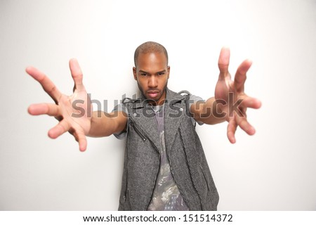Closeup portrait of an attractive man with arms outstretched  - stock photo