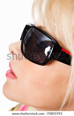 Closeup portrait of an attractive young woman wearing sunglasses - stock photo