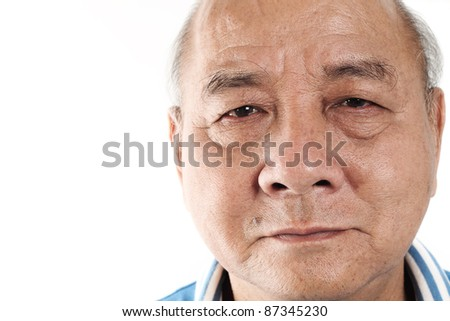 Closeup portrait of an elderly bald man on white backaground - stock photo