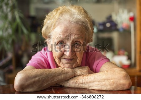 Closeup portrait of an elderly woman. - stock photo