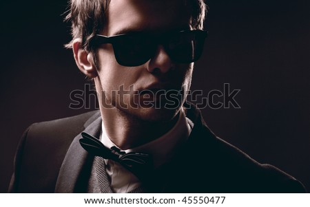 Closeup portrait of an elegant fashion man wearing sunglasses - stock photo