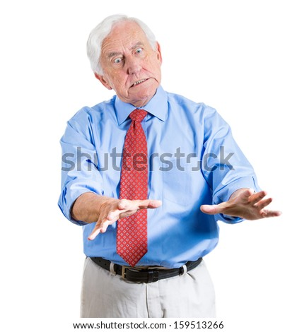 Closeup portrait of an old man, grandfather, corporate executive in blue shirt and red tie arguing with someone with hands in the air, looking very unhappy and angry, isolated on white background - stock photo