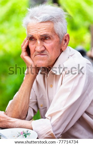 Closeup portrait of an old man outdoor - stock photo