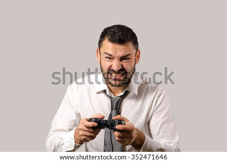 Closeup portrait of angry, frustrated businessman who play video game controller. Negative human emotions and facial expressions - stock photo