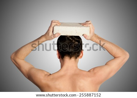 Closeup portrait of angry, frustrated man, pulling his hair out - stock photo