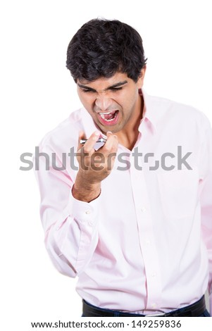 Closeup portrait of angry man shouting while on phone, isolated on white background with copy space - stock photo