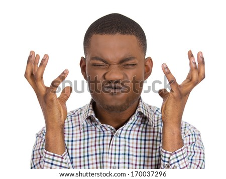 Closeup portrait of angry man with hands raised, eyes mouth shut in stress, isolated on white background. Negative emotion, facial expression, feelings, attitude, perception Conflict problems, issues.