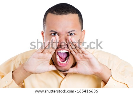 Closeup portrait of angry pissed off irritated guy wearing blue shirt, hands to mouth, screaming, shouting, yelling angry isolated on white background. Negative human emotion facial expression - stock photo