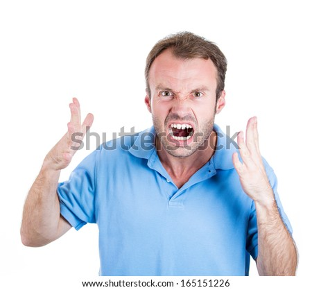 Closeup portrait of angry upset young mad guy, worker, employee, business man in blue shirt with hands up at you camera gesture, isolated on white background. Negative human emotion facial expression - stock photo