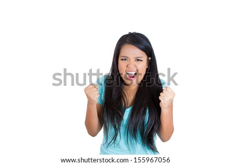 Closeup portrait of angry woman raising fists in air, isolated on white background with copy space