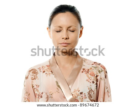 Closeup portrait of Asian woman with eyes closed in studio isolated on white background - stock photo