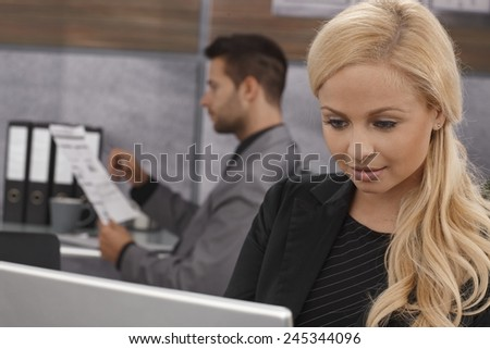 Closeup portrait of attractive blonde businesswoman working. - stock photo
