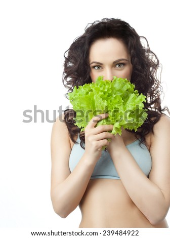 closeup portrait of attractive  caucasian  brunette isolated on white studio shot  face hair head and shoulders looking at camera eating salat - stock photo