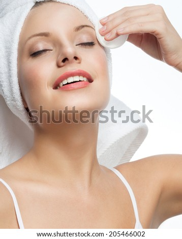 closeup portrait of attractive  caucasian smiling woman blond isolated on white studio shot lips toothy smile face hair head and shoulders towel mirrow cleaning cotton disc - stock photo