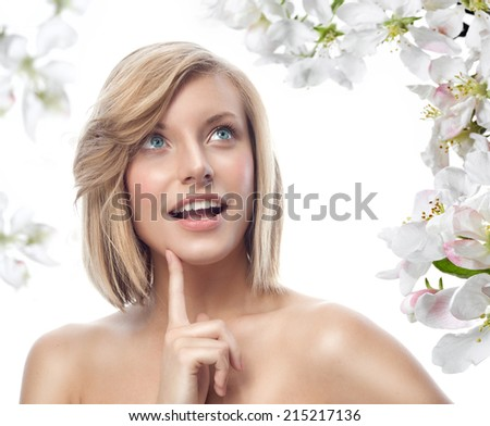 closeup portrait of attractive  caucasian smiling woman blond isolated on white studio shot lips toothy smile face hair head and shoulders looking up blue eyes tooth flowers aroma spring - stock photo