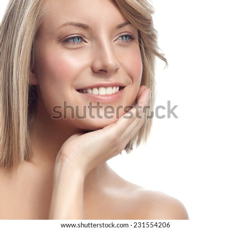 closeup portrait of attractive  caucasian smiling woman blond isolated on white studio shot lips toothy smile face hair head and shoulders  blue eyes tooth - stock photo