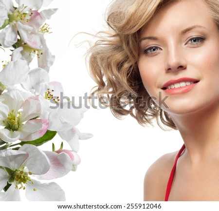 closeup portrait of attractive  caucasian smiling woman blond isolated on white studio shot lips toothy smile face hair head and shoulders looking at camera blue eyes tooth spring flowers - stock photo