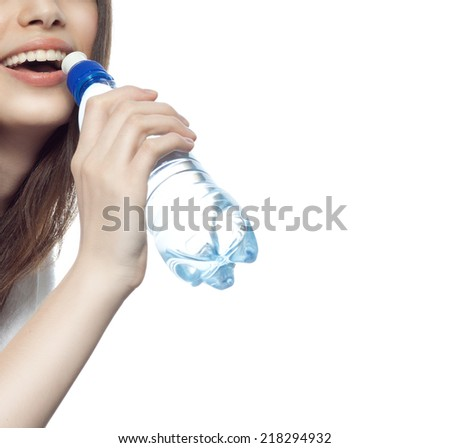 closeup portrait of attractive  caucasian smiling woman brunette isolated on white studio shot lips toothy smile face hair head and shoulders drinking water - stock photo
