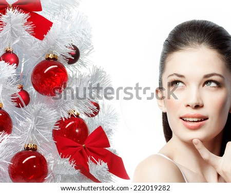 closeup portrait of attractive  caucasian smiling woman brunette isolated on white studio shot lips face hair head and shoulders looking up christmas  - stock photo